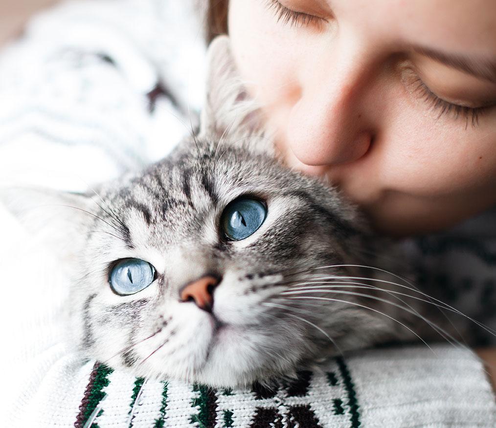 Woman Kissing Cat